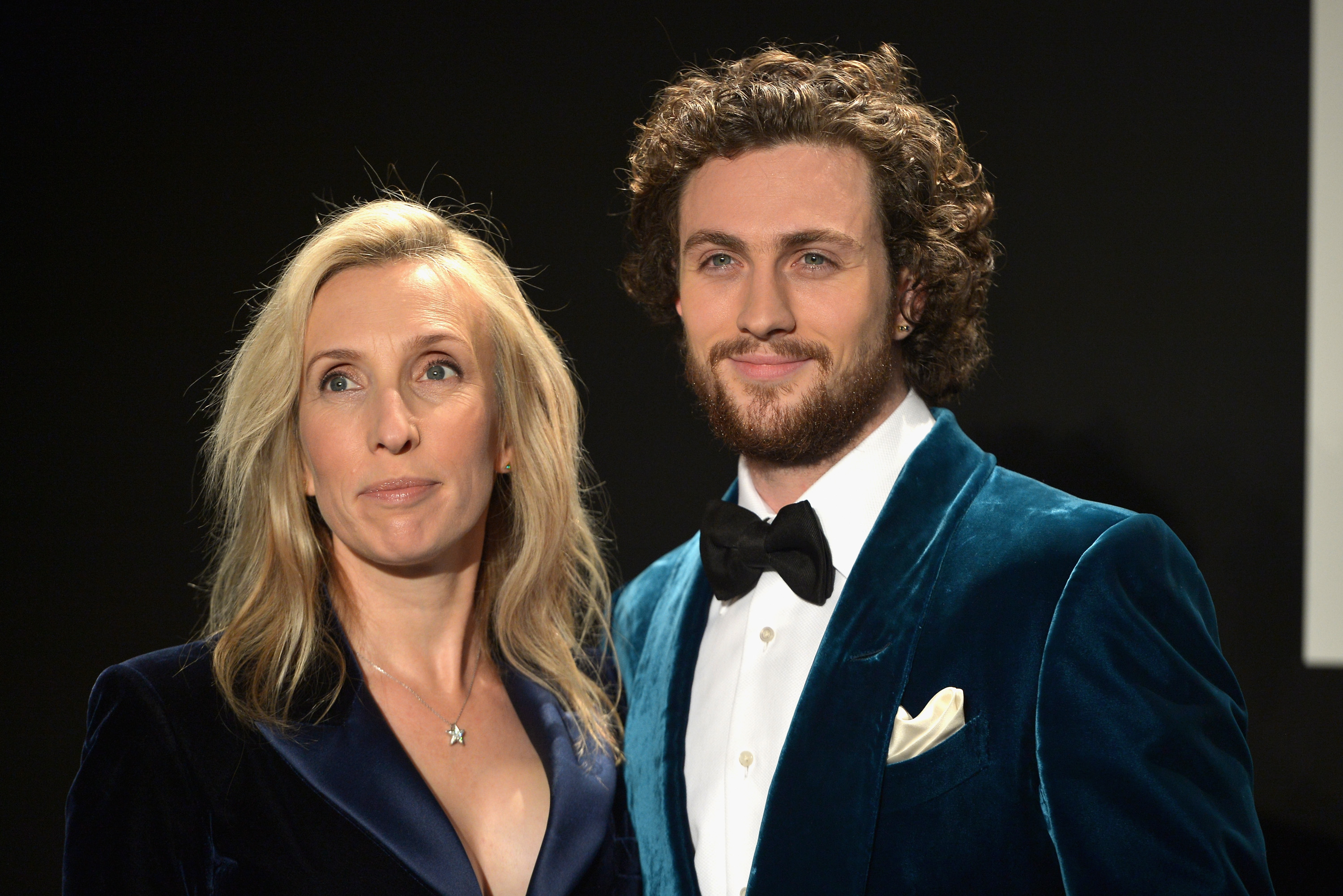 LOS ANGELES, CA - FEBRUARY 20: Director Sam Taylor-Johnson (L) and actor Aaron Taylor-Johnson, both wearing TOM FORD, attend the TOM FORD Autumn/Winter 2015 Womenswear Collection Presentation at Milk Studios in Los Angeles on February 20, 2015. (Photo by Charley Gallay/Getty Images for Tom Ford)